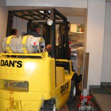 Moving new equipment through narrow hallways.