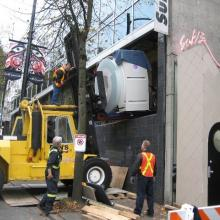 Moving in new MRI machine into medical building.