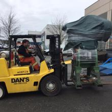 One of our 15,000lb Capacity Forklifts moving a piece of equipment