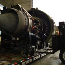 Installing GE90 Jet Engine for AC737 aircraft at YVR Airport.