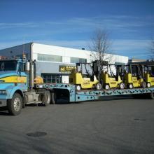 8,000 lb forklifts being delivered, via Len's Delivery.