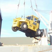 Low Clearance 33000 lbs capacity forklift, lowering into a Ship.