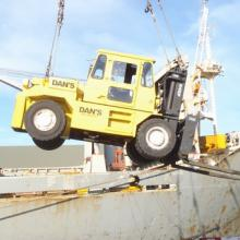 Being lifted into a ship to move large gear around.