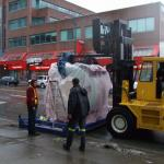 MRI machine waiting to be loaded into Medical Clinic, on Broadway.