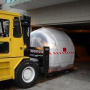 Sqeezing in a MRI machine into building parkade.